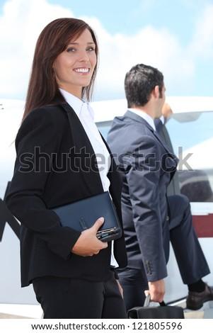 Couple boarding a light aircraft - stock photo