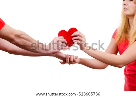 Couple. Boyfriend giving his girlfriend red heart love symbol. Happy romantic woman and man. Valentines day happiness concept