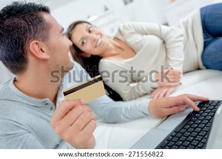 Couple buying online - stock photo