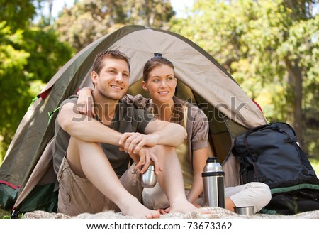 Couple camping in the park - stock photo