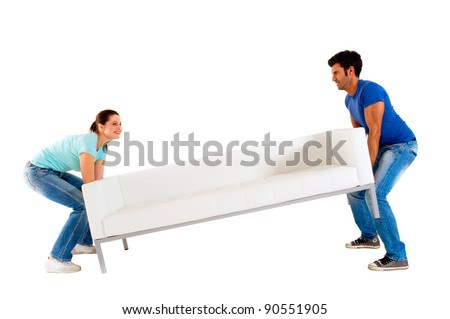 Couple carrying a sofa - stock photo