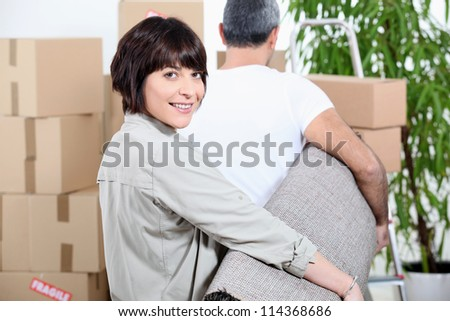 Couple carrying rug - stock photo