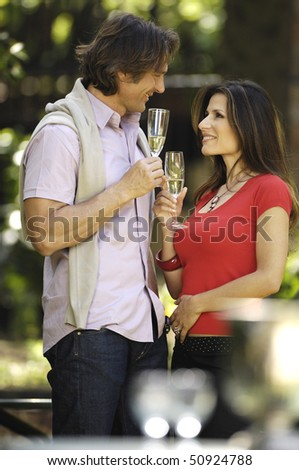 couple celebrating in the garden - stock photo