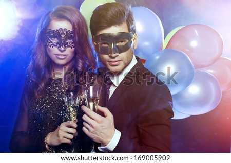 Couple celebrating new year's eve with champagne  - stock photo