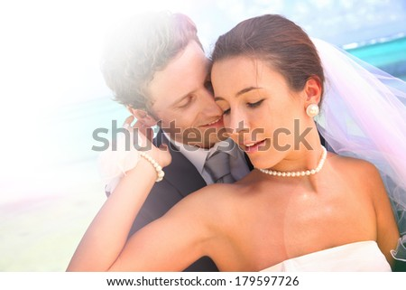 Couple celebrating wedding on the beach - stock photo