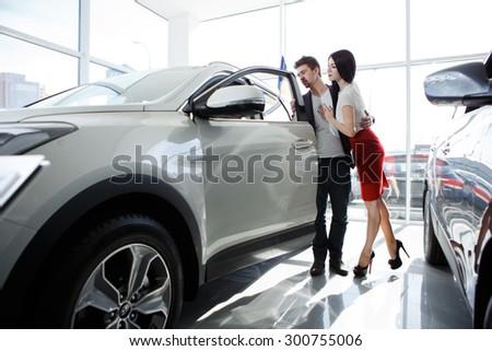 couple chooses the car. Attractive couple chooses a car - stock photo