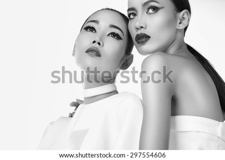 Couple close up portrait asian models in concept fashion shooting in studio - stock photo