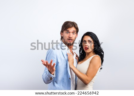 couple confused scary emotion over gray background