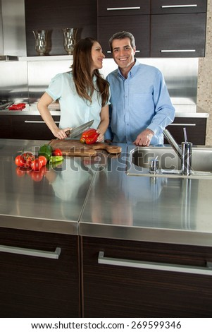 couple cooking dinner - stock photo
