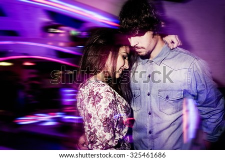 Couple dancing in a club - stock photo