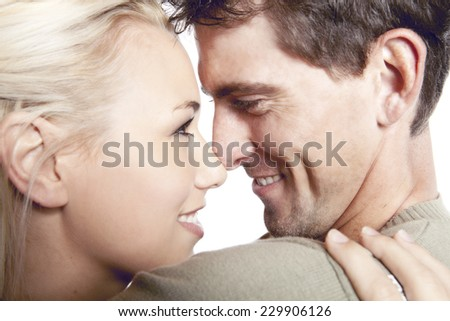Couple deeply in love staring into each others eyes - stock photo