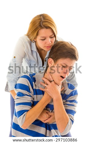 Couple demonstrating first aid techniques with woman performing heimlich in male choking. - stock photo