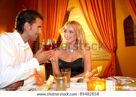 Couple dining in a fancy restaurant - stock photo