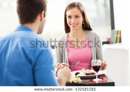 Couple dining in restaurant - stock photo