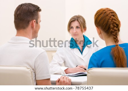 Couple discussing with female doctor sexologist - stock photo