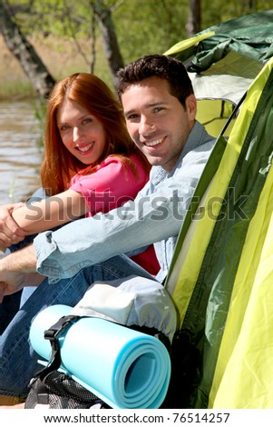 Couple doing camping in summer - stock photo