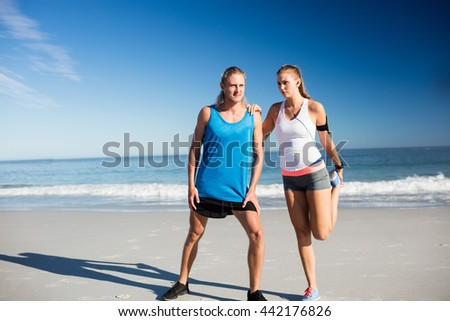 Couple doing sport together on the beach