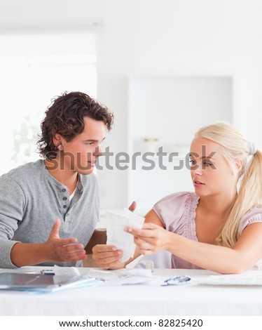 Couple doing their accounts in their living room - stock photo