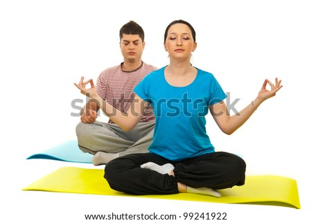 Couple doing yoga and sitting on gymnastics mats isolated on white background - stock photo