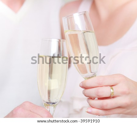 Couple drinking champagne cava in glasses after wedding romantic close up - stock photo