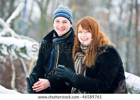 Couple drinking hot tea - stock photo