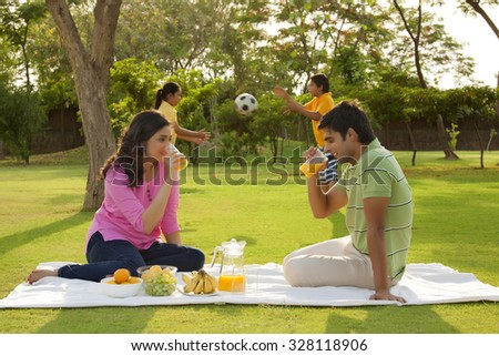 Couple drinking juice from glass - stock photo