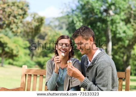 Couple eating an ice cream - stock photo