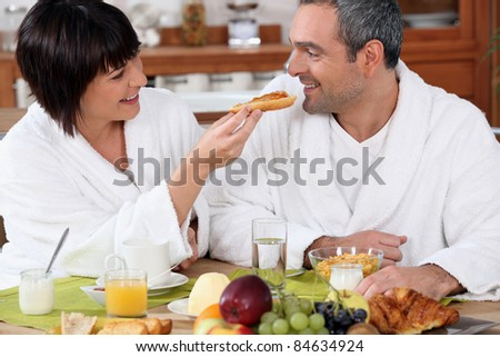 Couple eating breakfast - stock photo