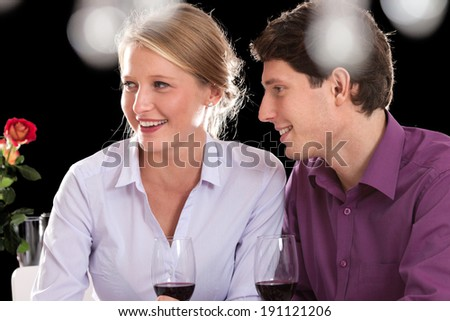 Couple eating dinner together after long day at work - stock photo