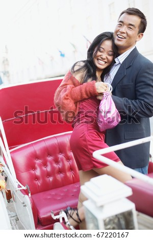 Couple embracing in carriage - stock photo