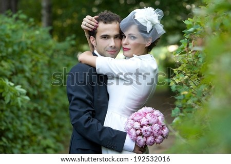 Couple embracing in the middle of nature. Wedding ceremony.  - stock photo