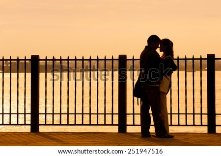 Couple embracing on Brooklyn Heights Promenade, NYC - stock photo