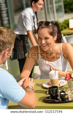 Couple enjoy coffee dessert restaurant sunny terrace eat cheesecake - stock photo