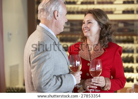 Couple Enjoying A Drink At A Bar Together - stock photo