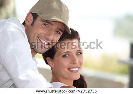 Couple enjoying a hot summer's day together - stock photo
