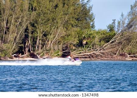 Couple enjoying a jet ski - stock photo