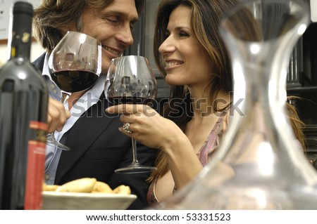 Couple enjoying a meal - stock photo