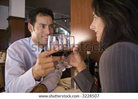 Couple enjoying a romantic dinner - stock photo