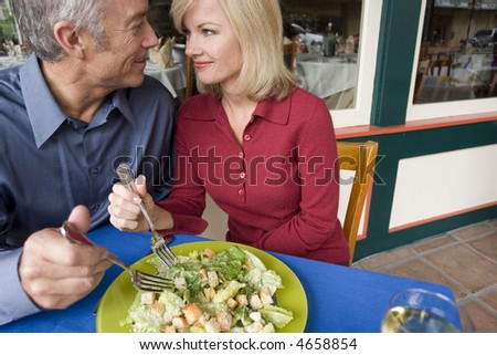 Couple enjoying a romantic lunch - stock photo