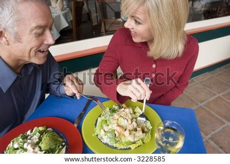Couple enjoying a romantic meal outside - stock photo