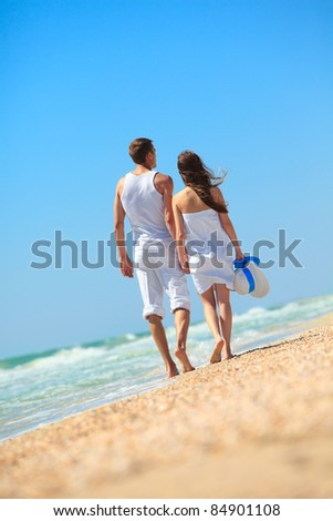 Couple enjoying a summer vacation. - stock photo