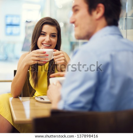 Couple enjoying coffee - stock photo
