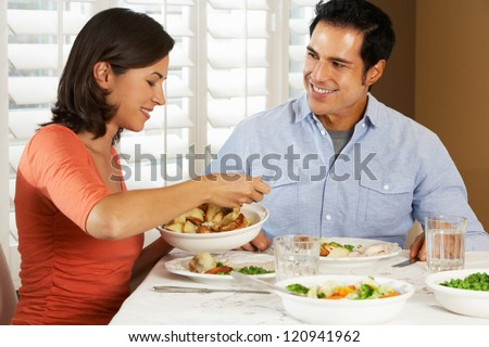 Couple Enjoying Meal At Home - stock photo