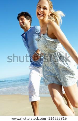 Couple Enjoying Romantic Beach Holiday - stock photo