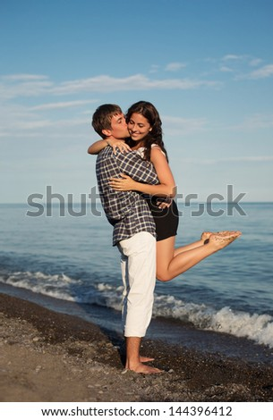 Couple Enjoying Romantic Beach Holiday