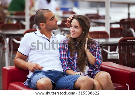 Couple enjoying their love at the bar - stock photo