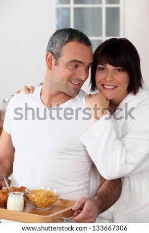 Couple enjoying weekend morning - stock photo