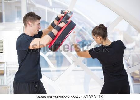 Couple exercising punching - stock photo