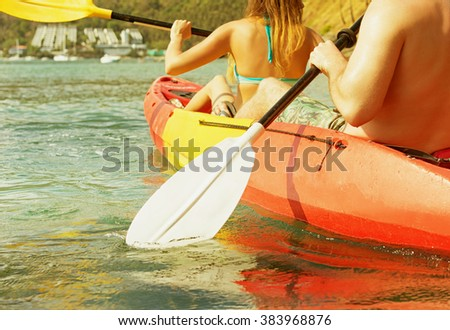 Couple exploring calm tropical bay by kayak.  - stock photo