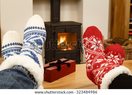 Couple feet in front of fire - stock photo